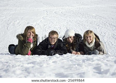 Young adults in the Snow - stock photo