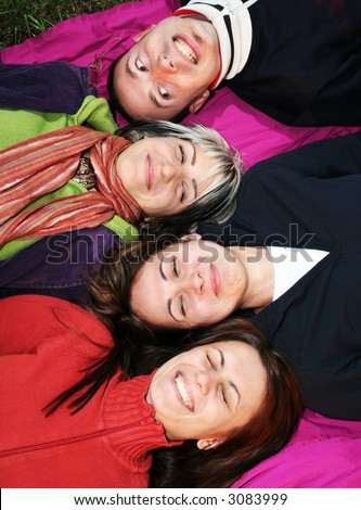 Young adults laugh. Happy friends smile and having fun. Friends laying together laughing - stock photo