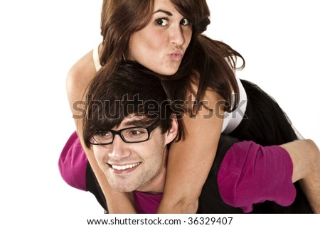 Young adults piggy back ride - stock photo