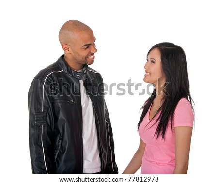 Young affectionate couple hugging - African American guy with Asian girlfriend. - stock photo