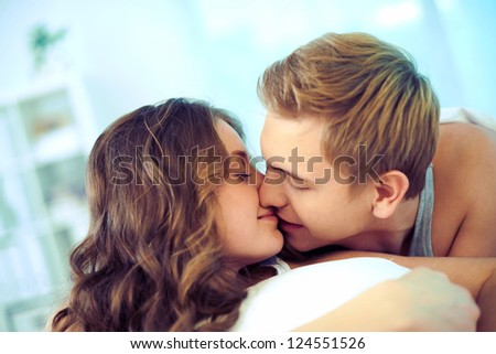 Young affectionate couple kissing - stock photo