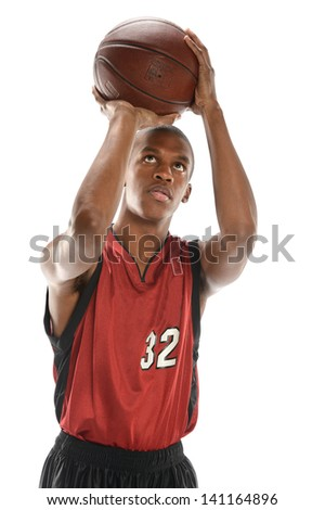 Young African American basketball player shooting ball isolated over white background - stock photo