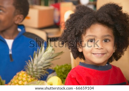 Young African American boy in supermarket - stock photo