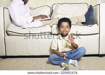 Young African American boy playing on floor - stock photo