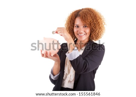 Young african american business woman holding a piggy bank, isolated on white background - African people - stock photo