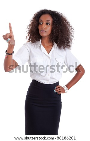 Young african american business woman pushing or pointing a transparent screen isolated on white background - stock photo