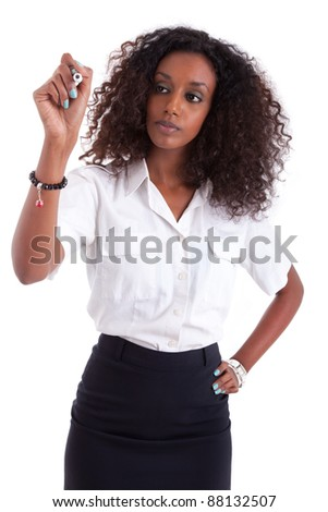 Young African american business woman  writing something on glass board with marker - stock photo