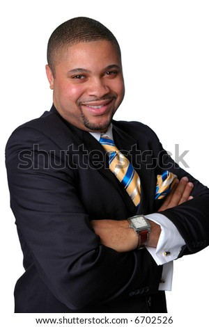 Young African American businessman with arms crossed smiling isolated over a white background.