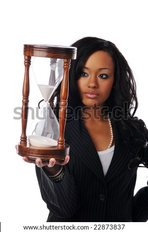 Young African American businesswoman holding a sand clock isolated on white - stock photo