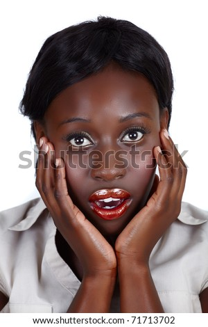 young African American businesswoman holding her face in the hands with open mouth in surprise, isolated on white - stock photo