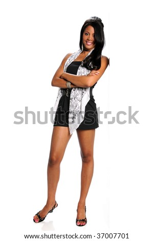 Young African American businesswoman leaning an white wall