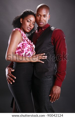 Young african american couple on black - stock photo