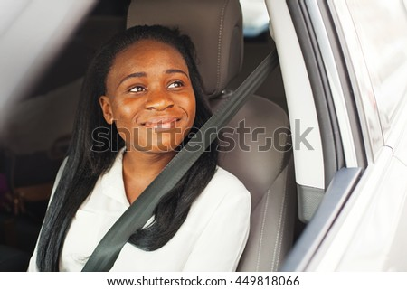 Young african american girl using seat belt in a car - stock photo
