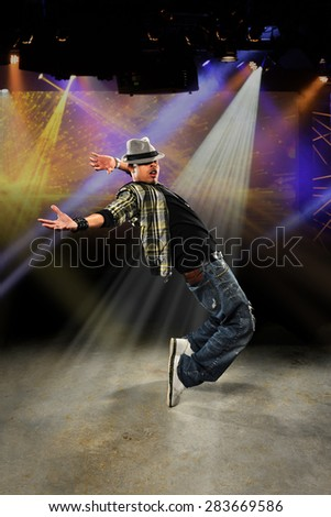 Young African American hip hop dancer performing on stage - stock photo