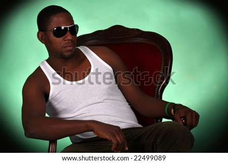 Young african american male on green background - stock photo