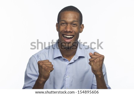 Young African-American man excited and cheering, horizontal  - stock photo