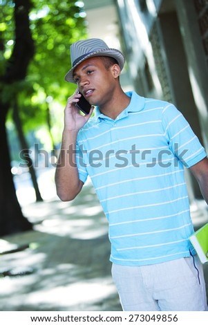 Young african american man on the phone - stock photo