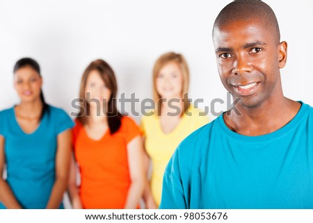 young african american man standing in front of group of girls - stock photo