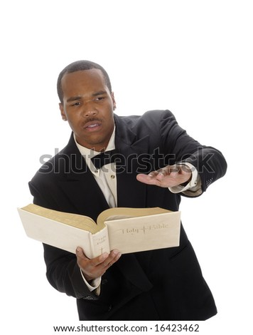 Young african american minister preaching from the bible - stock photo