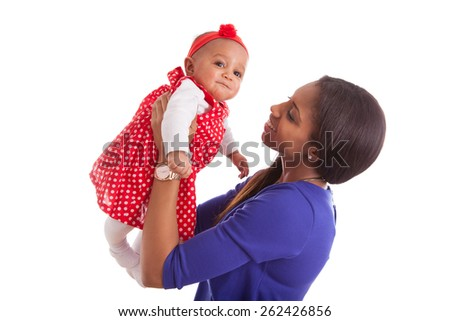 Young african american mother playing with her baby girl - stock photo