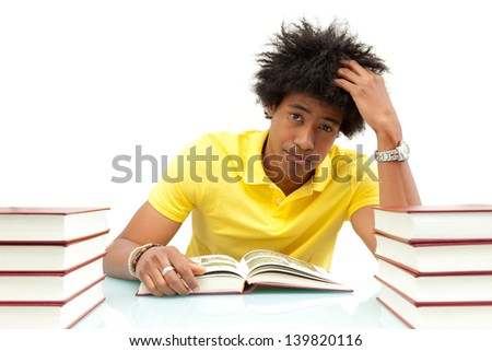 Young african american student reading books, over white background - African people - stock photo