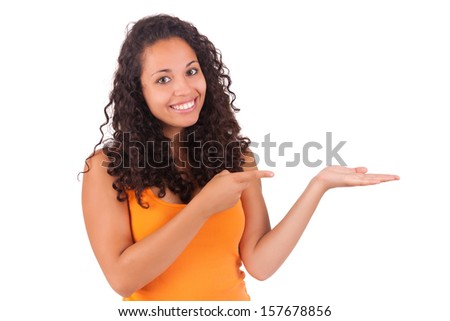 Young african american woman  displaying something isolated - stock photo
