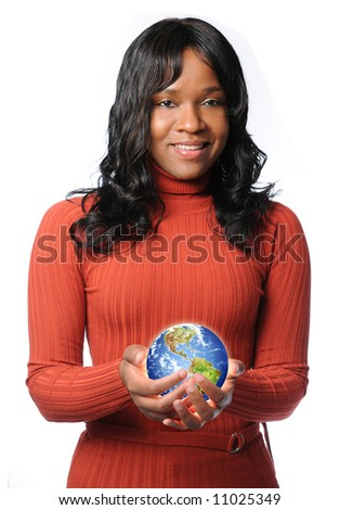 Young African American woman holding glowing earth - stock photo