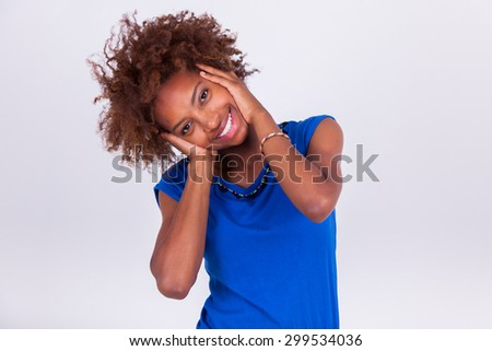 Young African American woman holding her frizzy afro hair - Black people - stock photo