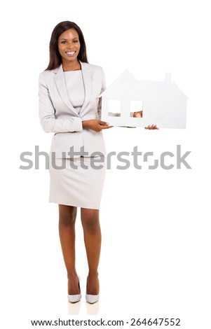 young african american woman holding paper house isolated on white - stock photo