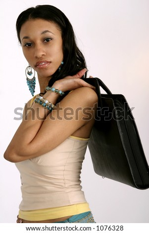 Young African American woman holding portfolio over her shoulder - stock photo