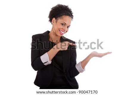 Young african american woman presenting something on empty palm, over white background - stock photo