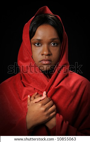 Young African American woman wearing a red veil - stock photo