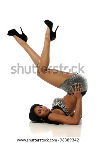 Young African American woman wearing mini skirt and high heels on a white background - stock photo