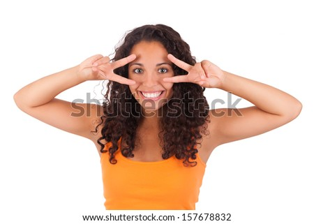 Young african american woman with her fingers over her eye isolated