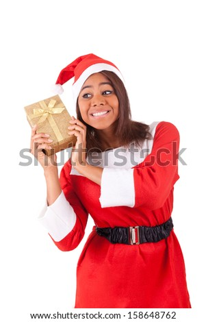 Young african american woman with  santa hat and gifts - stock photo