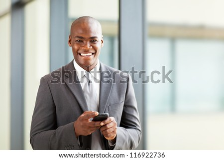 young african business executive with smart phone - stock photo