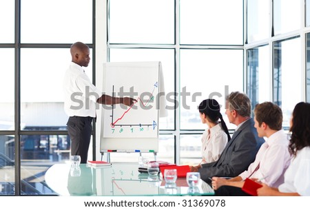 Young African businessman giving a presentation - stock photo