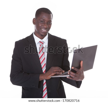 Young African Businessman Holding Laptop Over White Background