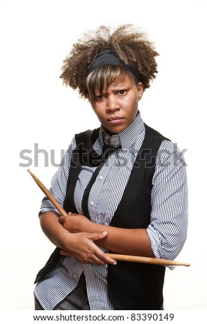 Young African girl poses with drumsticks against a white background. - stock photo