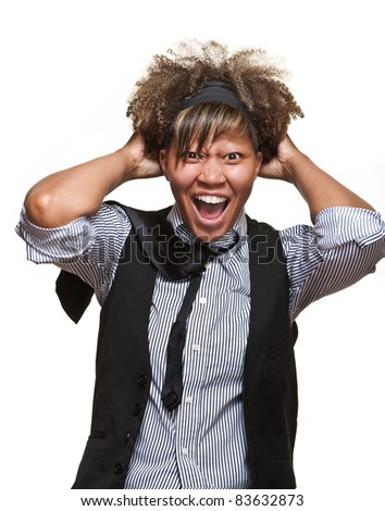 Young African girl pulls her hair out in frustration against a white background. - stock photo