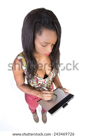 Young African girl using graphics tablet - stock photo