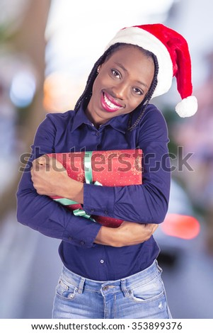 Young African girl with hat Christmas and gifts