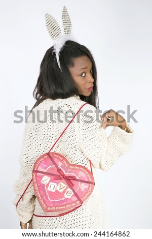 Young African girl with heart of valentines day - stock photo