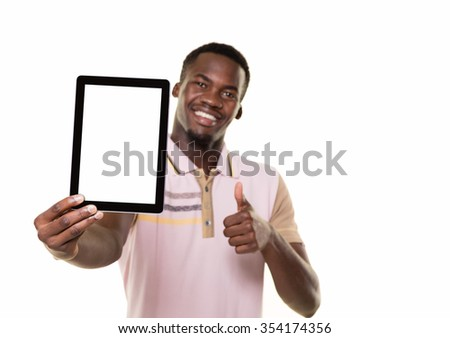 Young African man and tablet. - stock photo