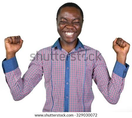 Young african man celebrating success - stock photo