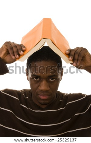 Young african man protect his head with a book - stock photo