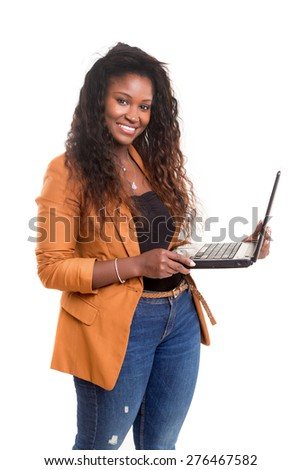 Young african student working with her laptop, isolated over a white background - stock photo