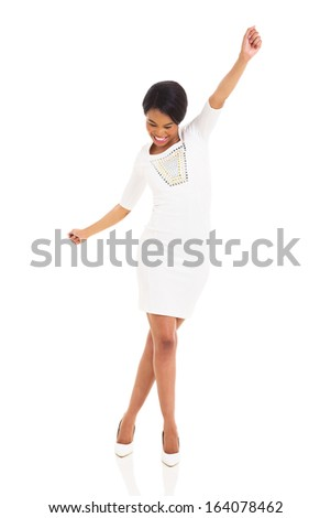 young african woman dancing on white background - stock photo