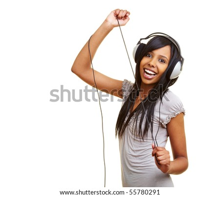 Young african woman dancing to music with headphones - stock photo