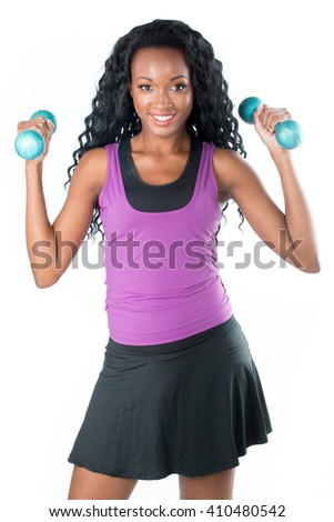 young african woman does exercises on white background - stock photo